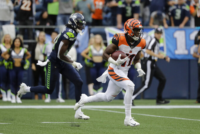 Cincinnati Bengals wide receiver John Ross (11) runs for a touchdown after a reception against the Seattle Seahawks during the first half of an NFL football game Sunday, Sept. 8, 2019, in Seattle. (AP Photo/John Froschauer)
