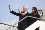 FILE - In this Jan. 24, 2020, photo, Vice President Mike Pence and his wife Karen, right, wave as they disembark from Air Force Two upon their arrival at Rome's Ciampino airport. (AP Photo/Alessandra Tarantino, File)