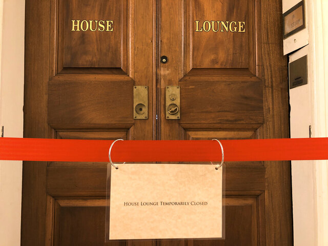 The Missouri House Lounge is cordoned off on Thursday, Jan. 21, 2021, at the state Capitol in Jefferson City, Mo. The room, which is a popular tourist site because of its ornate paintings, has been closed to regular tours due to COVID-19 concerns. The House canceled its session this week after a coronavirus outbreak. (AP Photo/David A. Lieb)