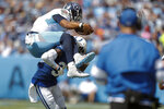 Tennessee Titans quarterback Marcus Mariota (8) tries to leap over Indianapolis Colts cornerback Pierre Desir (35) in the first half of an NFL football game Sunday, Sept. 15, 2019, in Nashville, Tenn. (AP Photo/Wade Payne)