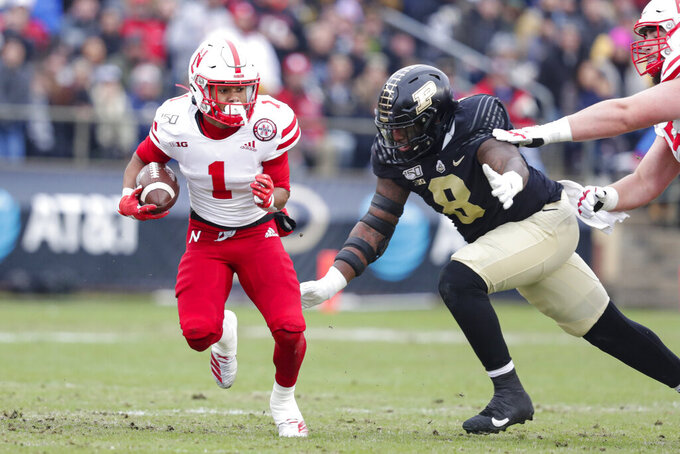 Nebraska wide receiver Wan'Dale Robinson (1) is chased down by Purdue defensive tackle Anthony Watts (8) during the first half of an NCAA college football game in West Lafayette, Ind., Saturday, Nov. 2, 2019. (AP Photo/Michael Conroy)