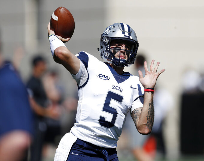New Hampshire Wildcats quarterback Christian Lupoli warms up before an NCAA college football game against Colorado Saturday, Sept. 15, 2018, in Boulder, Colo. (AP Photo/David Zalubowski)