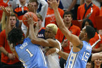 North Carolina guard Leaky Black (1) and teammate forward Garrison Brooks (15) pressure Virginia forward Mamadi Diakite, center, during the first half of an NCAA college basketball game in Richmond, Va., Sunday, Dec. 8, 2019. (AP Photo/Steve Helber)