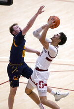 Stanford forward Jaiden Delaire (11) shoots over California guard Ryan Betley (00) during the second half of an NCAA college basketball game in Stanford, Calif., Sunday, Feb. 7, 2021. (AP Photo/Tony Avelar)