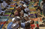 Muslims make traditional Friday prayers at a mosque near to the Emir's palace in Kano, northern Nigeria Friday, Feb. 15, 2019. Nigeria is due to hold general elections on Saturday, pitting incumbent President Muhammadu Buhari against leading opposition presidential candidate Atiku Abubakar. (AP Photo/Ben Curtis)