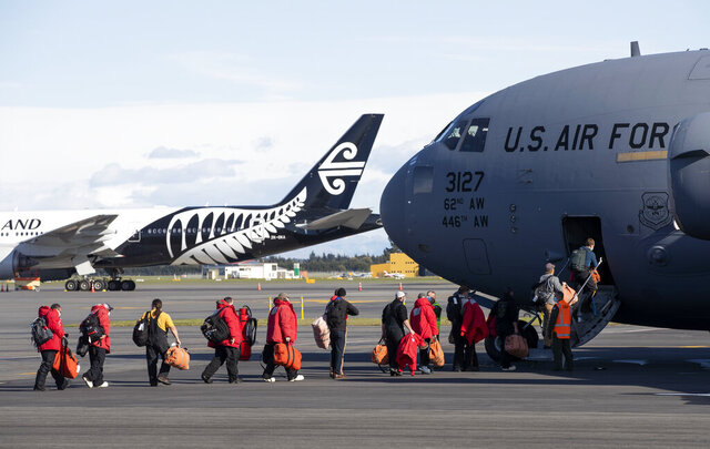Staff board a U.S. Air Force C-17 as they prepare to take the season's first flight to McMurdo Station in Antarctica from Christchurch Airport, New Zealand, Monday, Sept. 14, 2020. The first U.S. flight into Antarctica following months of winter darkness left from New Zealand Monday with crews extra vigilant about keeping out the coronavirus. (AP Photo/Mark Baker)