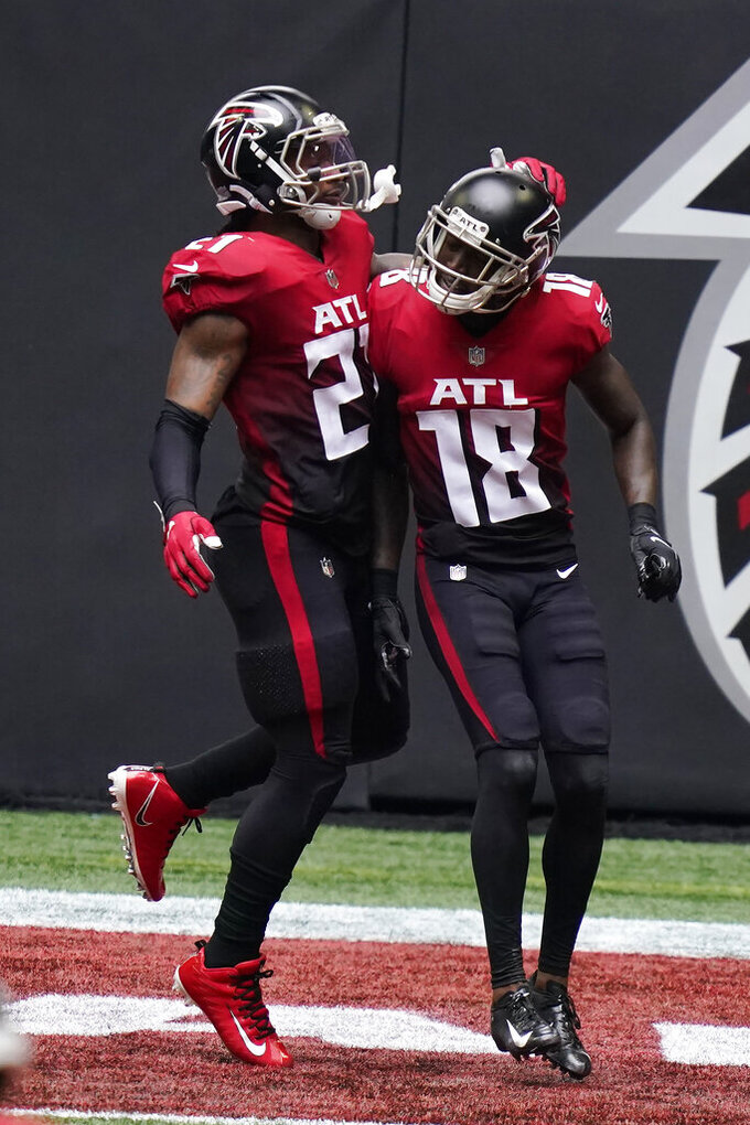 Atlanta Falcons running back Todd Gurley (21) celebrates the touchdown of Atlanta Falcons wide receiver Calvin Ridley (18) during the first half of an NFL football game, Sunday, Oct. 25, 2020, in Atlanta. (AP Photo/Brynn Anderson)