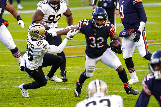 New Orleans Saints cornerback P.J. Williams (26) attempts to tackle Chicago Bears running back David Montgomery (32) in the first half of an NFL football game in Chicago, Sunday, Nov. 1, 2020. (AP Photo/Charles Rex Arbogast)