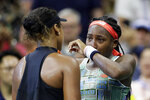 Coco Gauff, right, of the United States, wipes away tears while talking to Naomi Osaka, of Japan, after Osaka defeated Gauff during the third round of the U.S. Open tennis tournament Saturday, Aug. 31, 2019, in New York. (AP Photo/Adam Hunger)