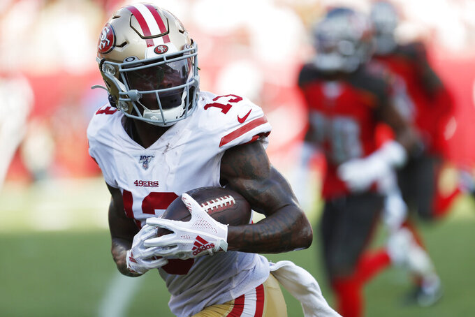 San Francisco 49ers wide receiver Richie James (13) runs to the end zone for a touchdown against the Tampa Bay Buccaneers during the second half an NFL football game, Sunday, Sept. 8, 2019, in Tampa, Fla. (AP Photo/Mark LoMoglio)