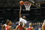 Washington forward Jayden McDaniels (0) shoots over Ball State during the second half of an NCAA college basketball game, Sunday, Dec. 22, 2019, in Honolulu. (AP Photo/Marco Garcia)