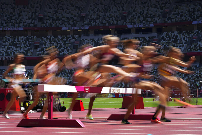 Runners compete in a heat of the women's 3,000-meter steeplechase at the 2020 Summer Olympics, Sunday, Aug. 1, 2021, in Tokyo. (AP Photo/Petr David Josek)