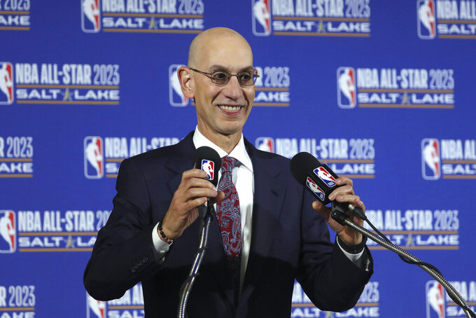 FILE - In this Oct. 23, 2019, file photo, NBA Commissioner Adam Silver speaks during a news conference at Vivint Smart Home Arena in Salt Lake City. Something is finally clear in the uncertain NBA. Players believe they're going to play games again this season. The obvious questions like how, where and when remain unanswered. (AP Photo/Rick Bowmer, File)