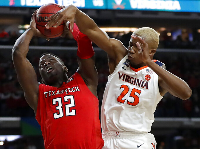 Texas Tech's Norense Odiase (32) shoots against Virginia's Mamadi Diakite (25) during the second half in the championship of the Final Four NCAA college basketball tournament, Monday, April 8, 2019, in Minneapolis. (AP Photo/Jeff Roberson)