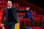 FILE - In this file photo dated Thursday, May 13, 2021, Real Madrid's head coach Zinedine Zidane gestures during the Spanish La Liga soccer match against Granada at Los Carmenes stadium in Granada, Spain. Zidane has stepped down as coach of Real Madrid, it is announced Thursday May 27, 2021.   (AP Photo/Fermin Rodriguez, FILE)