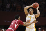 Tennessee forward Grant Williams (2) looks to pass while Arkansas guard Isaiah Joe (1) defends in the first half of an NCAA college basketball game, Tuesday, Jan. 15, 2019, in Knoxville, Tenn. (AP Photo/Shawn Millsaps)