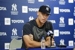 New York Yankees' Aaron Judge pauses while speaking at a news conferece after a spring training baseball workout Tuesday, Feb. 18, 2020, in Tampa, Fla. (AP Photo/Frank Franklin II)