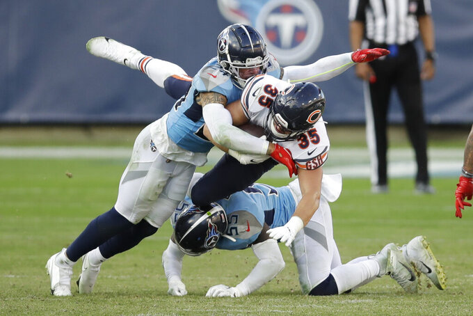 Chicago Bears running back Ryan Nall (35) is hit by Tennessee Titans strong safety Kenny Vaccaro (24) in the second half of an NFL football game Sunday, Nov. 8, 2020, in Nashville, Tenn. (AP Photo/Ben Margot)