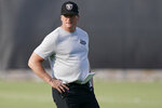 FILE - Las Vegas Raiders head coach Jon Gruden looks on during an NFL football practice in HNenderson, Nev., in this Tuesday, June 15, 2021, file photo. Gruden and the Raiders were fined a total of $650,000 and docked a sixth-round draft pick for repeated violations of the NFL's COVID-19 protocols. (AP Photo/John Locher, File)