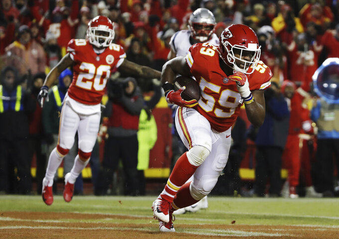Kansas City Chiefs inside linebacker Reggie Ragland (59) runs after intercepting a pass during the first half of the AFC Championship NFL football game against the New England Patriots, Sunday, Jan. 20, 2019, in Kansas City, Mo. (AP Photo/Elise Amendola)