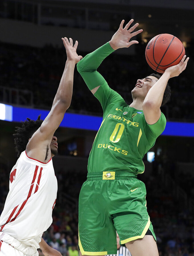 Oregon guard Will Richardson (0) shoots against Wisconsin forward Aleem Ford during the first half of a first round men's college basketball game in the NCAA Tournament, Friday, March 22, 2019, in San Jose, Calif. (AP Photo/Chris Carlson)