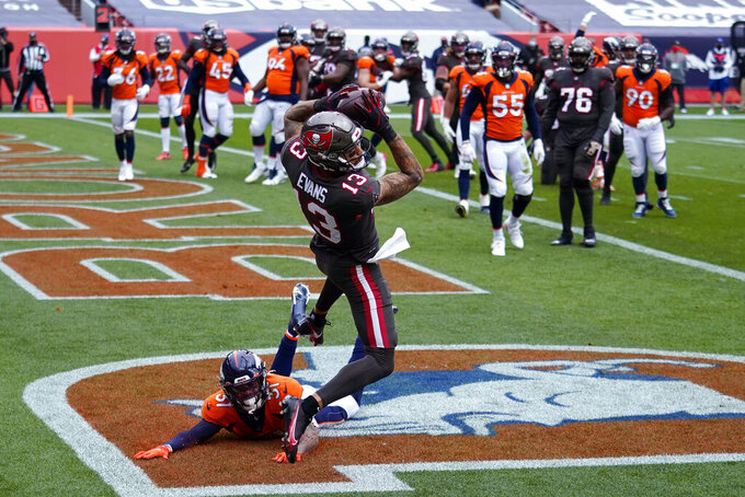 Tampa Bay Buccaneers wide receiver Mike Evans makes a catch in the end zone for a touchdown as Denver Broncos free safety Justin Simmons defends during the first half of an NFL football game Sunday, Sept. 27, 2020, in Denver. (AP Photo/Jack Dempsey)