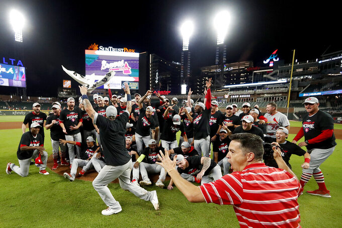 The St. Louis Cardinals celebrate after beating the Atlanta Braves 13-1 in Game 5 of their National League Division Series baseball game Wednesday, Oct. 9, 2019, in Atlanta.(AP Photo/John Bazemore)