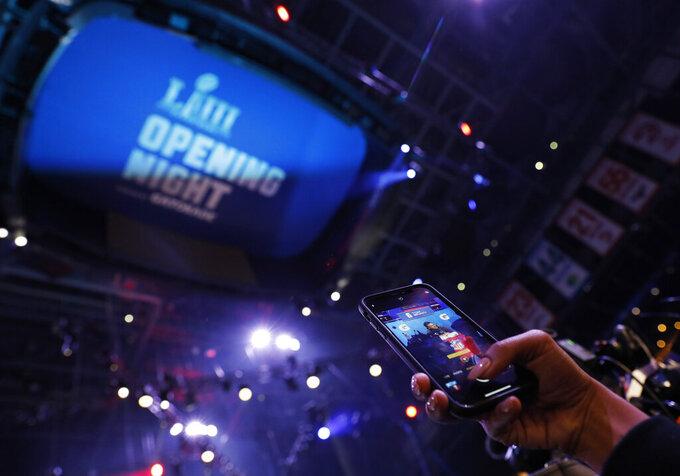 Someone records New England Patriots' Tom Brady talking during Opening Night for the NFL Super Bowl 53 football game Monday, Jan. 28, 2019, in Atlanta. (AP Photo/David Goldman)