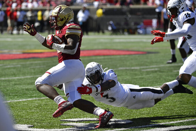 Louisville defensive back Russ Yeast (3) attempts to tackle Boston College running back David Bailey (26) during the first half of an NCAA college football game in Louisville, Ky., Saturday, Oct. 5, 2019. (AP Photo/Timothy D. Easley)