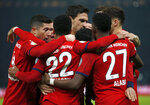 Bayern's scorer Serge Gnabry and his teammates celebrate their side's first goal during a German Soccer Cup round of sixteen match between Hertha BSC Berlin and FC Bayern Munich in Berlin, Germany, Wednesday, Feb. 6, 2019. (AP Photo/Michael Sohn)