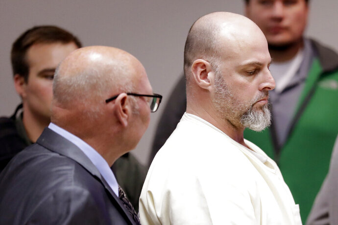 Curtis Watson, right, stands as a preliminary hearing is recessed Wednesday, Nov. 20, 2019, in Ripley, Tenn. Watson is charged with murdering Tennessee Department of Correction department administrator Debra Johnson after Watson escaped from the West Tennessee State Penitentiary in August. (AP Photo/Mark Humphrey, Pool)