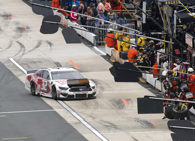 Corey LaJoie heads to his pit box to have his hood repaired at the Drydene 400 - Monster Energy NASCAR Cup Series playoff auto race, Sunday, Oct. 6, 2019, at Dover International Speedway in Dover, Del. (AP Photo/Jason Minto)
