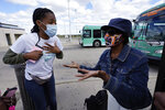 Wendy Caldwell-Liddell, left, who helped start Mobilize Detroit, a newly formed grassroots organization, talks to Margaret Roberts about voting in Detroit, Friday, Sept. 18, 2020. Both President Donald Trump and Democratic presidential nominee Joe Biden are battling for support among Black voters across Michigan, and Biden's running mate, Sen. Kamala Harris, will be in the state on Tuesday, Sept. 22. (AP Photo/Paul Sancya)