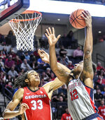 Mississippi forward Bruce Stevens (12) shoots as Georgia's Nicolas Claxton (33) defends during an NCAA college basketball game in Oxford, Miss., Saturday, Feb. 23, 2019. (Bruce Newman/The Oxford Eagle via AP)