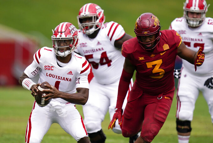 Louisiana-Lafayette quarterback Levi Lewis (1) runs from Iowa State defensive end JaQuan Bailey (3) during the first half of an NCAA college football game, Saturday, Sept. 12, 2020, in Ames, Iowa. (AP Photo/Charlie Neibergall)