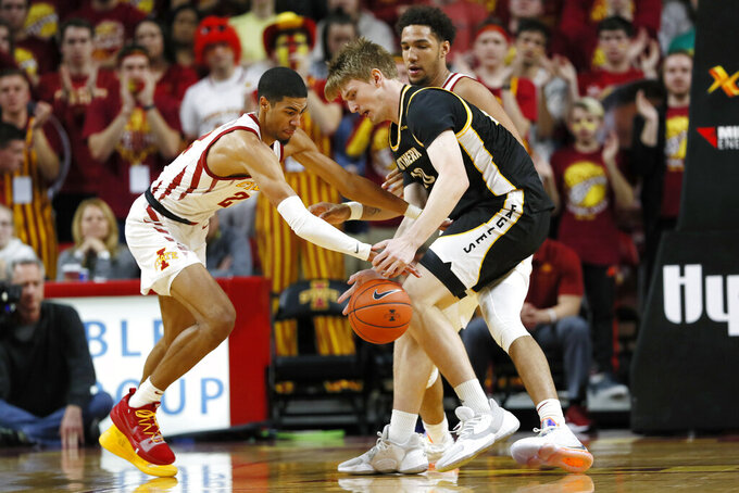 Iowa State guard Tyrese Haliburton, left, tries to steal the ball from Southern Mississippi forward Hunter Dean, right, during the first half of an NCAA college basketball game, Tuesday, Nov. 19, 2019, in Ames, Iowa. (AP Photo/Charlie Neibergall)