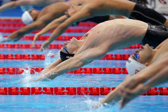 Ryan Murphy of the United States swims during a semifinal in the men's 100-meter backstroke at the 2020 Summer Olympics, Monday, July 26, 2021, in Tokyo, Japan. (AP Photo/Martin Meissner)