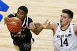 Wake Forest guard Daivien Williamson (4) and Notre Dame forward Nate Laszewski (14) battle for a rebound during the second half of an NCAA college basketball game in the first round of the Atlantic Coast Conference tournament in Greensboro, N.C., Tuesday, March 9, 2021. (AP Photo/Gerry Broome)
