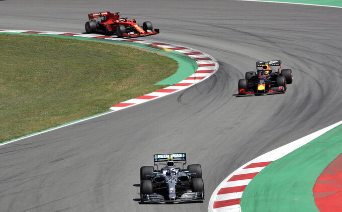 Mercedes driver Valtteri Bottas of Finland leads Red Bull driver Max Verstappen of the Netherland's and Ferrari driver Sebastian Vettel of Germany during the Spanish Formula One race at the Barcelona Catalunya racetrack in Montmelo, just outside Barcelona, Spain, Sunday, May 12, 2019. (AP Photo/Emilio Morenatti)