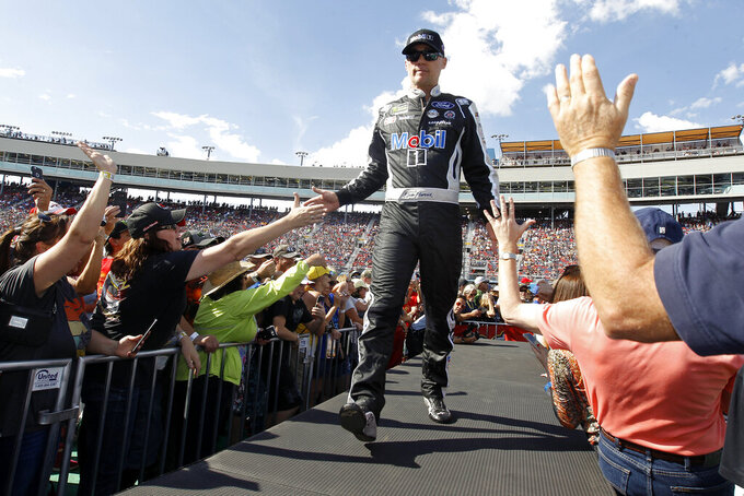 Kevin Harvick greets fans during driver introductions prior to the NASCAR Cup Series auto race at ISM Raceway, Sunday, Nov. 10, 2019, in Avondale, Ariz. (AP Photo/Ralph Freso)