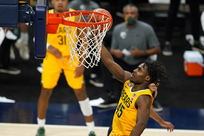 Baylor's Davion Mitchell (45) shoots during the second half of the team's NCAA college basketball game against Illinois, Wednesday, Dec. 2, 2020, in Indianapolis. Baylor won 82-69. (AP Photo/Darron Cummings)