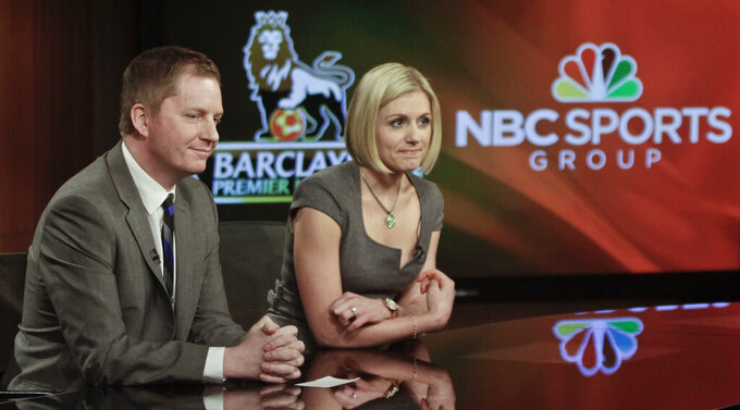 FILE - In this April 16, 2013, file photo, Arlo White, left, and Rebecca Lowe listen during a joint NBC and English Premier League (EPL) press conference in New York. Arlo White is used to the ebbs and flows of a Premier League season, but the past couple weeks have been a rollercoaster. White will call Saturday's, May 8, 2021, Manchester City-Chelsea match on NBC as City looks to clinch its third league title in four seasons. This comes less than a week after White was across town at Old Trafford and had to describe fans storming the field, which led to the cancellation of Manchester United's match against Liverpool. (AP Photo/Bebeto Matthews, File)