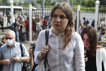 Anna Pavlikova, a member of the New Greatness group who are charged with the organisation of an extremist association, arrives for a court hearing in Moscow, Russia, Thursday, Aug. 6, 2020. Arrests of the two youngest members — 17-year-old Anna Pavlikova and 19-year-old Maria Dubovik — prompted a mass protest in August 2018, after which the two teenagers were released under house arrest. (AP Photo/Pavel Golovkin)