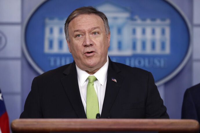 Secretary of State Mike Pompeo briefs reporters about additional sanctions placed on Iran, at the White House, Friday, Jan. 10, 2019, in Washington with and Treasury Secretary Steve Mnuchin. (AP Photo/ Evan Vucci)