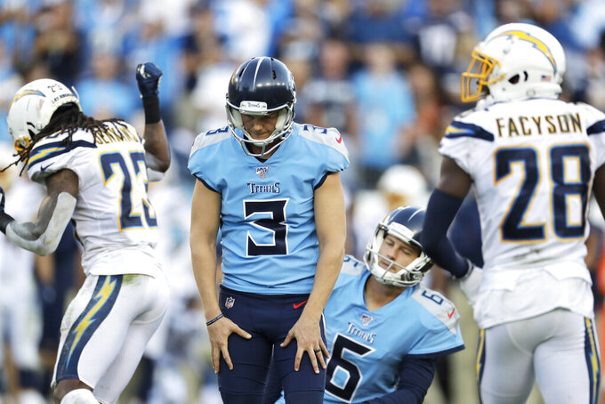 Tennessee Titans kicker Cody Parkey (3) reacts to missing an extra point by hitting the right upright in the second half of an NFL football game against the Los Angeles Chargers Sunday, Oct. 20, 2019, in Nashville, Tenn. (AP Photo/James Kenney)
