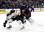 Columbus Blue Jackets forward Nick Foligno, right, works against Boston Bruins forward David Krejci, of the Czech Republic, during the second period of Game 4 of an NHL hockey second-round playoff series in Columbus, Ohio, Thursday, May 2, 2019. (AP Photo/Paul Vernon)