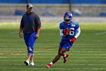 New York Giants wide receiver Darius Slayton (86) makes a catch in front of head coach Joe Judge during an NFL football team practice Thursday, May 27, 2021, in East Rutherford, N.J. (AP Photo/Adam Hunger)