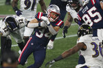 New England Patriots running back Rex Burkhead, center, carries the ball as Baltimore Ravens safeties DeShon Elliott (32) and Chuck Clark (36) give chase in the first half of an NFL football game, Sunday, Nov. 15, 2020, in Foxborough, Mass. (AP Photo/Elise Amendola)