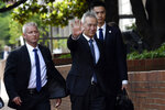 Chinese Vice Premier Liu He waves as he arrives for trade talks at the Office of the United States Trade Representative in Washington, Thursday, May 9, 2019. (AP Photo/Susan Walsh)