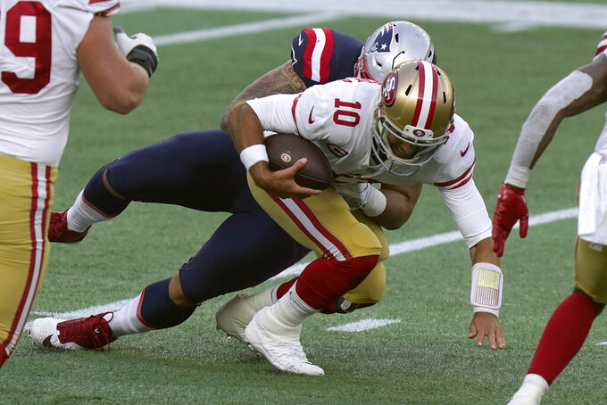 New England Patriots defensive lineman Lawrence Guy, rear, sacks San Francisco 49ers quarterback Jimmy Garoppolo in the first half of an NFL football game, Sunday, Oct. 25, 2020, in Foxborough, Mass. (AP Photo/Steven Senne)